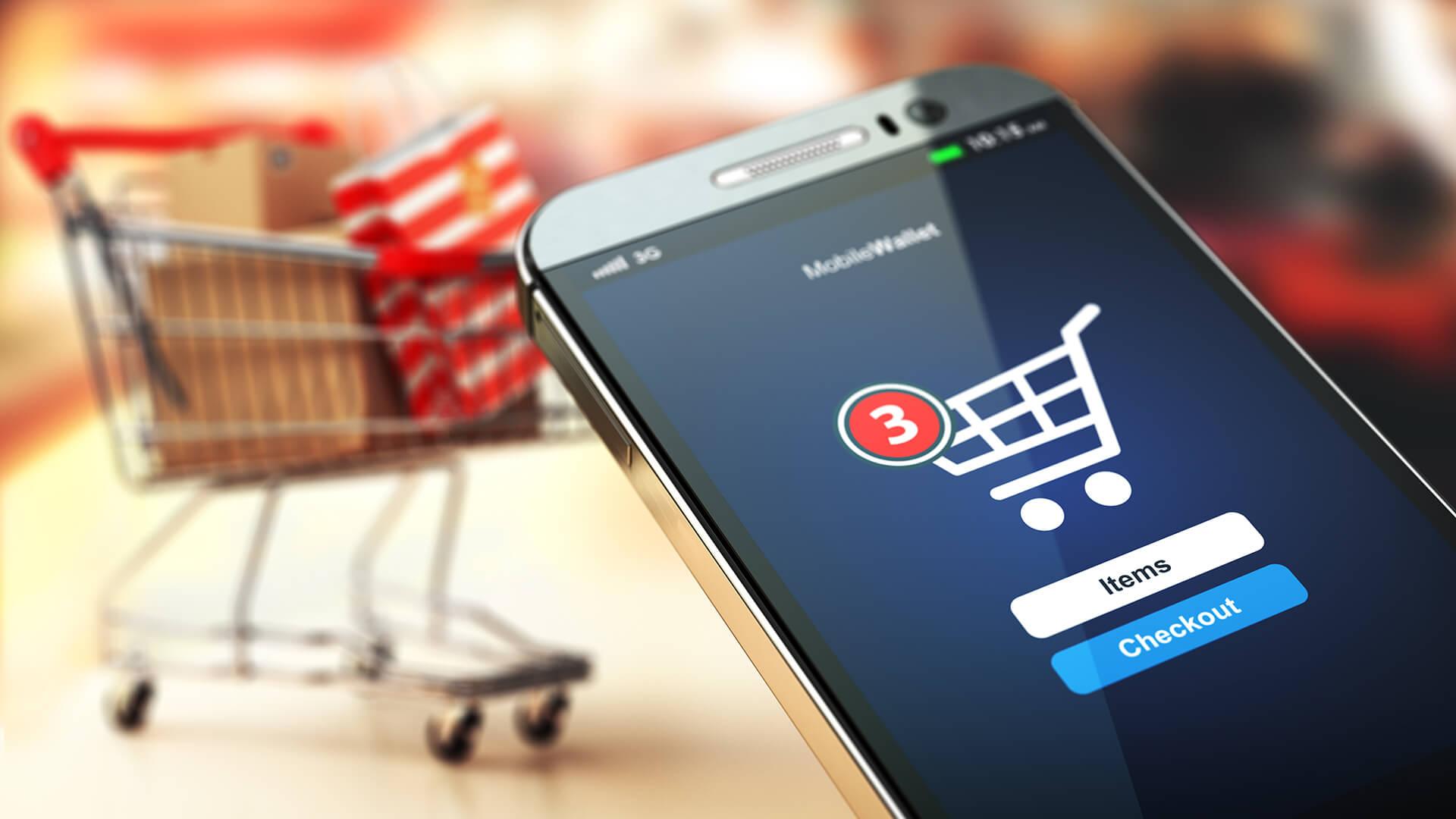 imagem com carrinho de compras au fundo e em primeiro plano um smartphone com uma tela de checkout.